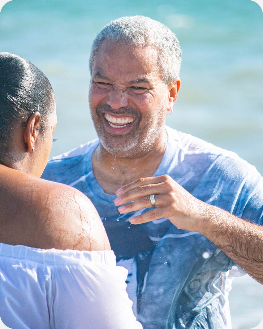 Man being baptized at the beach.